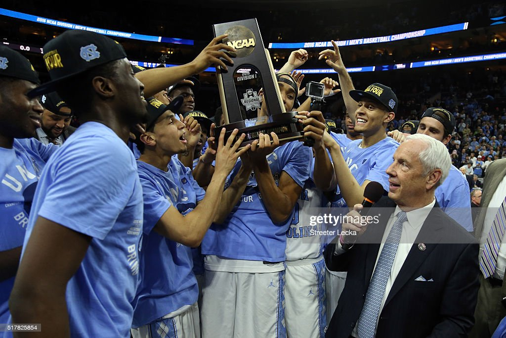 The North Carolina Tar Heels celebrate by hoisting the trophy after defeating the Notre Dame Fighting Irish with a score of 74 to 88 in the 2016 NCAA...