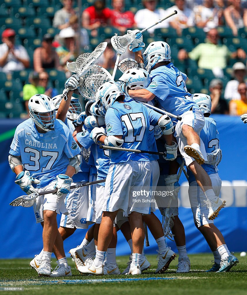The North Carolina Tar Heels celebrate their 18-13 win over of the Loyola (MD) Greyhounds in a semi-final match in the NCAA Division I Men's Lacrosse Championship at Lincoln Financial Field on May 28, 2016 in Philadelphia, Pennsylvania.