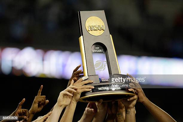 The North Carolina Tar Heels celebrates with the championship trophy after defeating the Michigan State Spartans 8972 during the 2009 NCAA Division I...