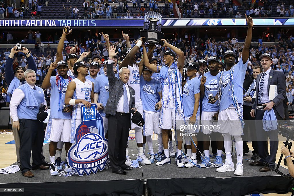 The North Carolina Tar Heels hold up the conference trophy after defeating the Virginia Cavaliers 6157 to win the 2016 ACC Basketball Tournament at...
