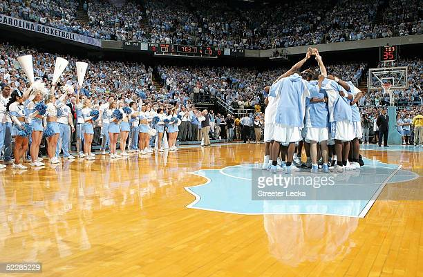 The North Carolina Tar Heels huddle up before the start of their game on Senior Day against the Duke Blue Devils on March 6 2005 at the Dean E Smith...