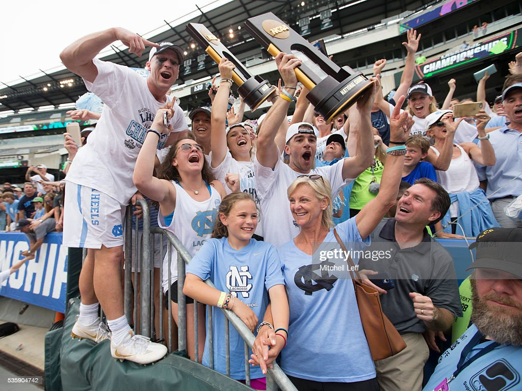 The North Carolina Tar Heels mens and womens lacrosse teams celebrate with both of their National Championship trophies after defeating the Maryland Terrapins in the NCAA Division I Men's Lacrosse Championship at Lincoln Financial Field on May 30, 2016 in Philadelphia, Pennsylvania. The Tar Heels defeated the Terrapins 14-13.