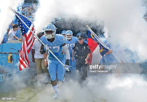The North Carolina Tar Heels take the field for a game against the James Madison Dukes at Kenan Stadium on September 17 2016 in Chapel Hill North...