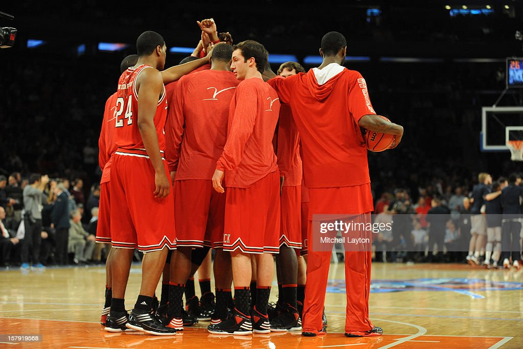 The North Carolina Wolfpack huddle before the Jimmy V Classic college basketball game against the Connecticut Huskies on December 4, 2012 at Madison Square Garden in New York, New York. The Wolfpack won 69-65.