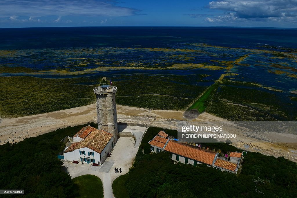 The north coast of the Ile de Re island, western France, is seen from the Saint Clement des Baleines lighthouse on June 25, 2016. / AFP / PIERRE