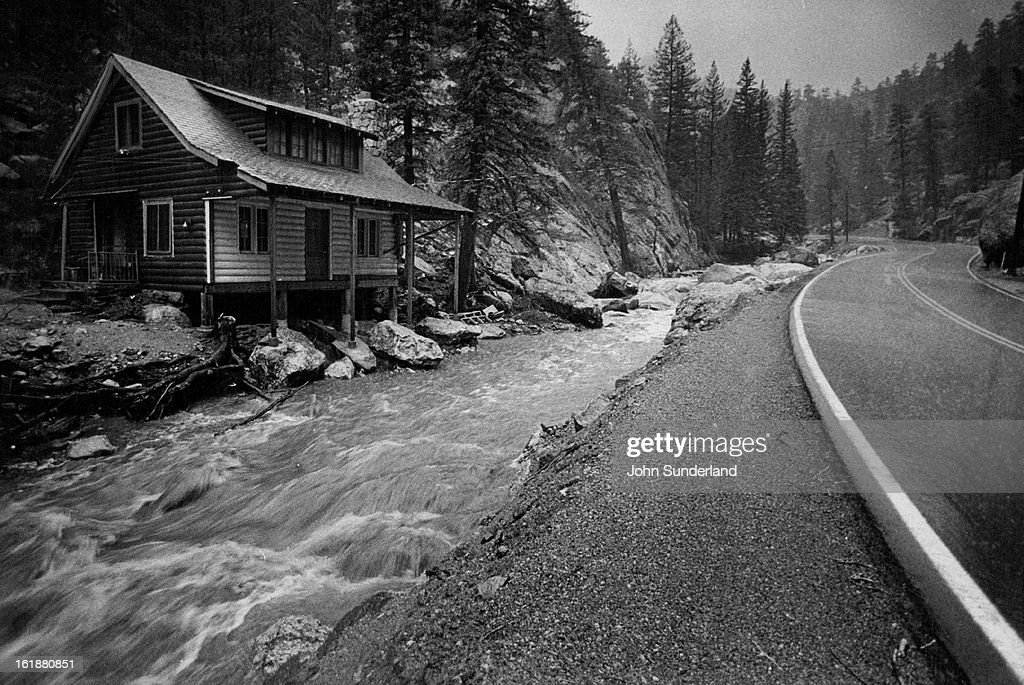 MAY 8 1978 MAY 18 1978 The North Fork of the Big Thompson River runs muddy and fast beside a house damaged in flood of 1976 This time the house...