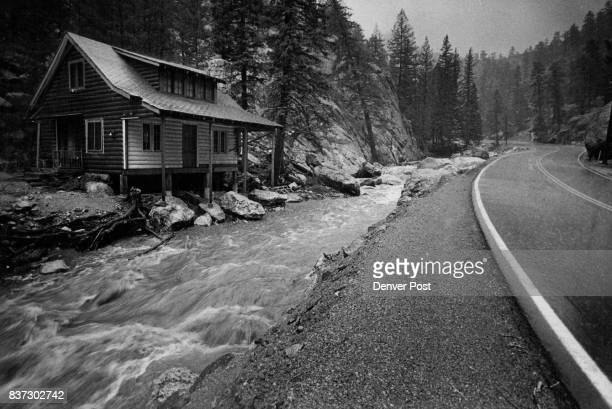The North Fork of the Big Thompson River runs muddy and fast beside a house damaged in flood of 1976 This time the house escaped damage Credit Denver...