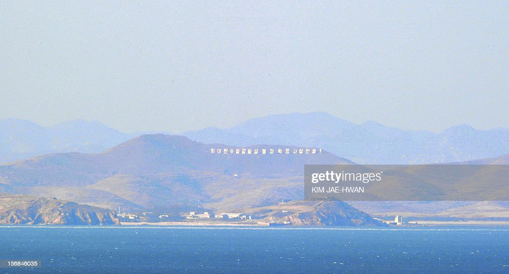 The North Korea seafront is pictured from an observation area on the South's Yeonpyeong island on November 23, 2012. South Korea marked on November 23, 2012 the anniversary of North Korea's 2010 shelling of a border island with a military drill and memorials, clouded by the threat of a fresh attack from Pyongyang. AFP PHOTO / KIM JAE-HWAN