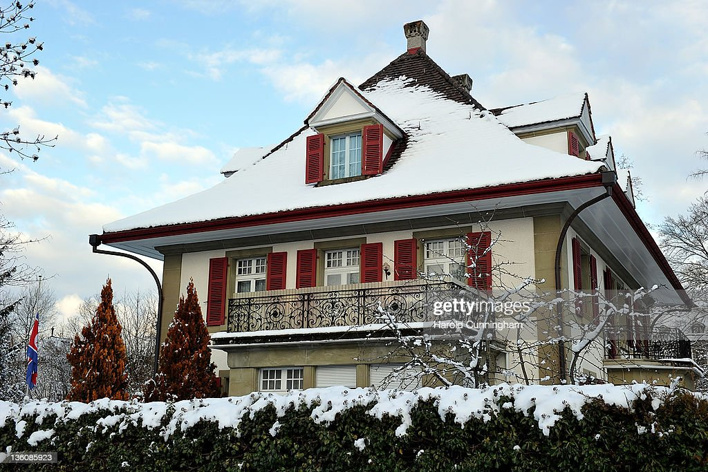 The North Korean flag flies at half mast at the North Korean embassy on December 19, 2011 in Muri Bei Berne, Berne, Switzerland. Following the death of North Korean leader Kim Jong-il of a heart attack on December 17, 2011 at the age of 69, his third son Kim Jong-Un is expected to succeed his father. Kim Jong-Un is believed to have studied at the International School of Berne, under a pseudonym, which provides education for 280 students of diplomatic, academic and business families of over 40 nationalities.