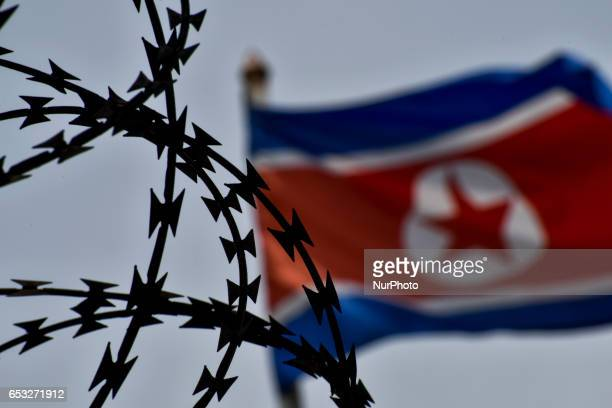 The North Korean flag is pictured at the North Korean embassy in Kuala Lumpur on March 14 2017 Malaysia's police chief confirmed March 10 that the...