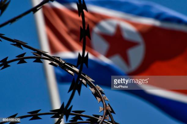 The North Korean flag is pictured at the North Korean embassy in Kuala Lumpur Malaysia on March 22 2017 Malaysia has used DNA sample from one of Kim...