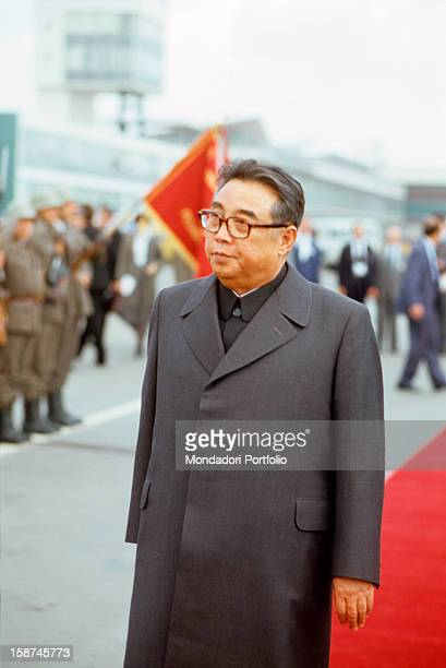 The North Korean president Kim Il Sung born Kim Songju inspects a military line while he crosses a red carpet at the funeral of the marshal Tito...