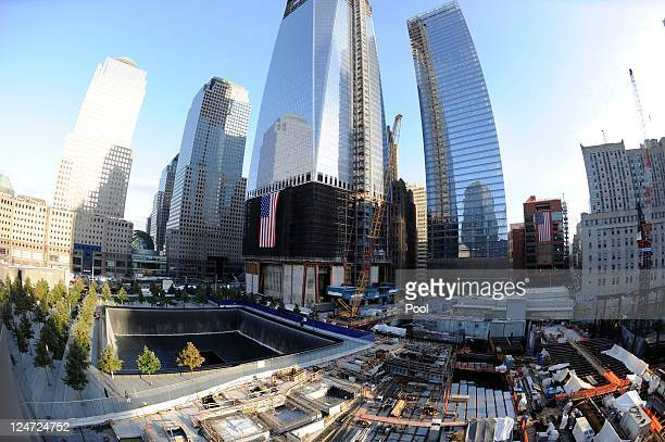 The North Pool of the 9/11 Memorial with One World Trade Center under construction at rear during the tenth anniversary ceremonies of the September...