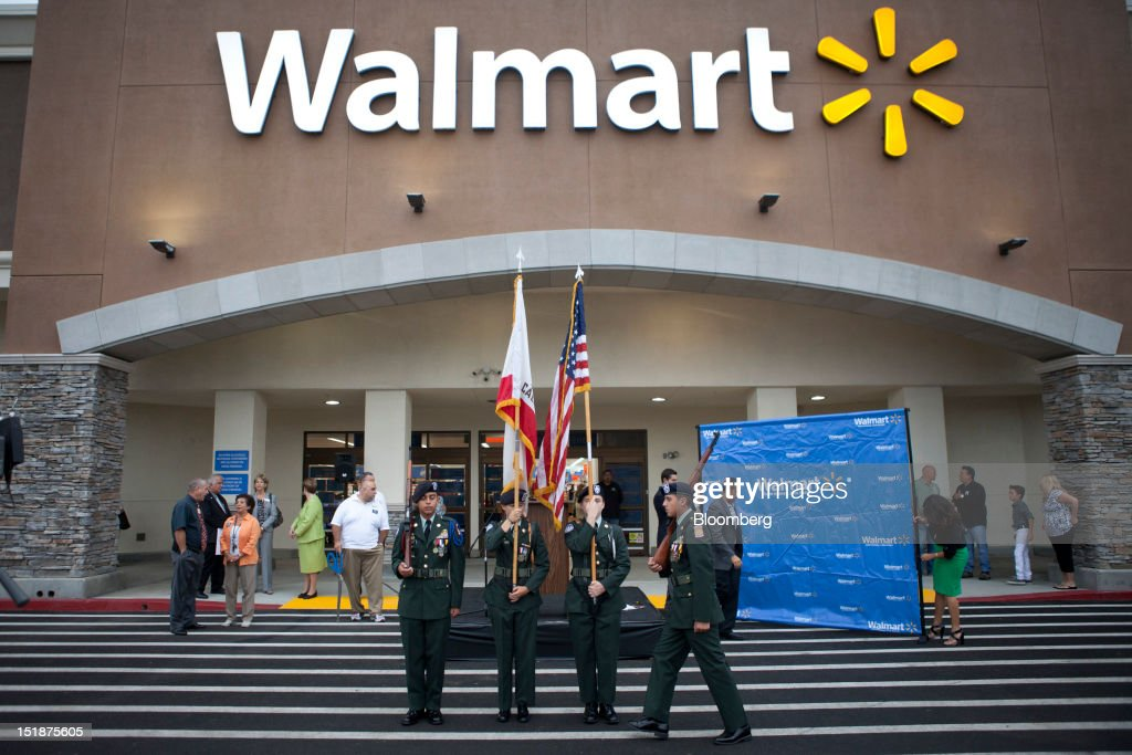 The North Torrance High School JROTC (Junior Reserve Officer Training Corps) color guard practices before the grand opening of a new Wal-Mart Stores Inc. location in Torrance, California, U.S., on Wednesday, Sept. 12, 2012. The store, which was the first to open in Los Angeles County since 2006, was built inside of a former Mervyn's clothing store. Photographer: Patrick Fallon/Bloomberg via Getty Images