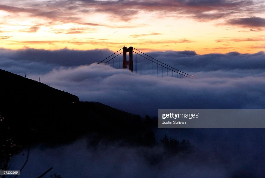The north tower of the Golden Gate Bridge is blanketed by fog as the sun rises October 8, 2007 in Sausalito, California. Temperatures around the San Francisco Bay and coast are expected to be in the 50's to 60's under partly cloudy skies October 8.