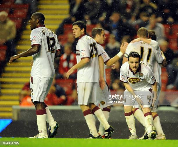 The Northampton Town players celebrate their second goal during the Carling Cup 3rd round game between Liverpool and Northampton Town at Anfield on...