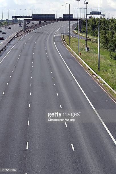 The northbound M6 motorway near Warrington is empty as police perform a rolling road block for safety during a motorist's protest at the continuing...