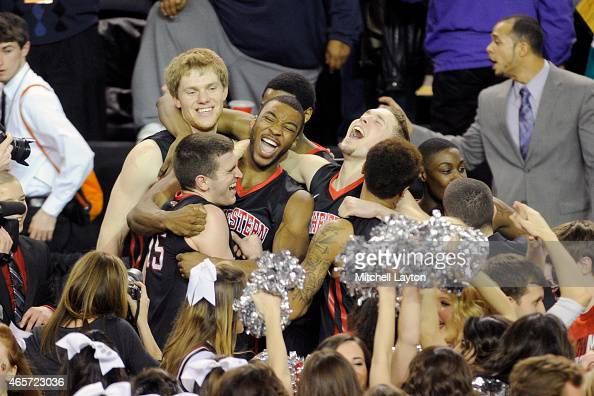 The Northeastern Huskies celebrate winning the Championships of the CAA Basketball Tournament against the William Mary Tribe at the Royal Farms Arena...