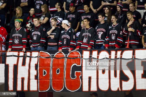 The Northeastern University Huskies fans cheer from 'The Dog House' for the Huskies hockey team against the Boston College Eagles during NCAA hockey...
