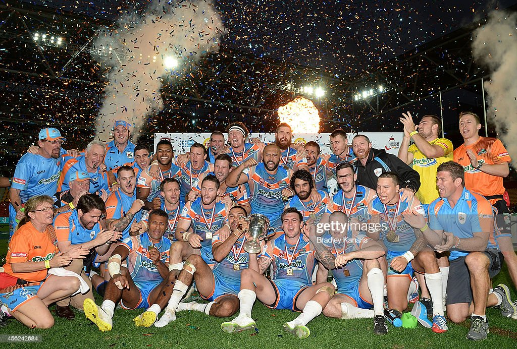 The Northen Pride celebrate victory after the Intrust Super Cup Grand Final match between Northern Pride and Easts Tigers at Suncorp Stadium on September 28, 2014 in Brisbane, Australia.