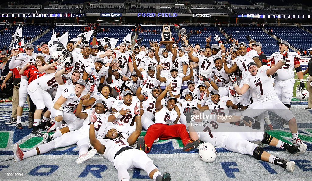 The Northern Illinois Huskies celebrate a MAC Championship win over the Bowling Green Falcons at Ford Field on December 5 2014 in Detroit Michigan...