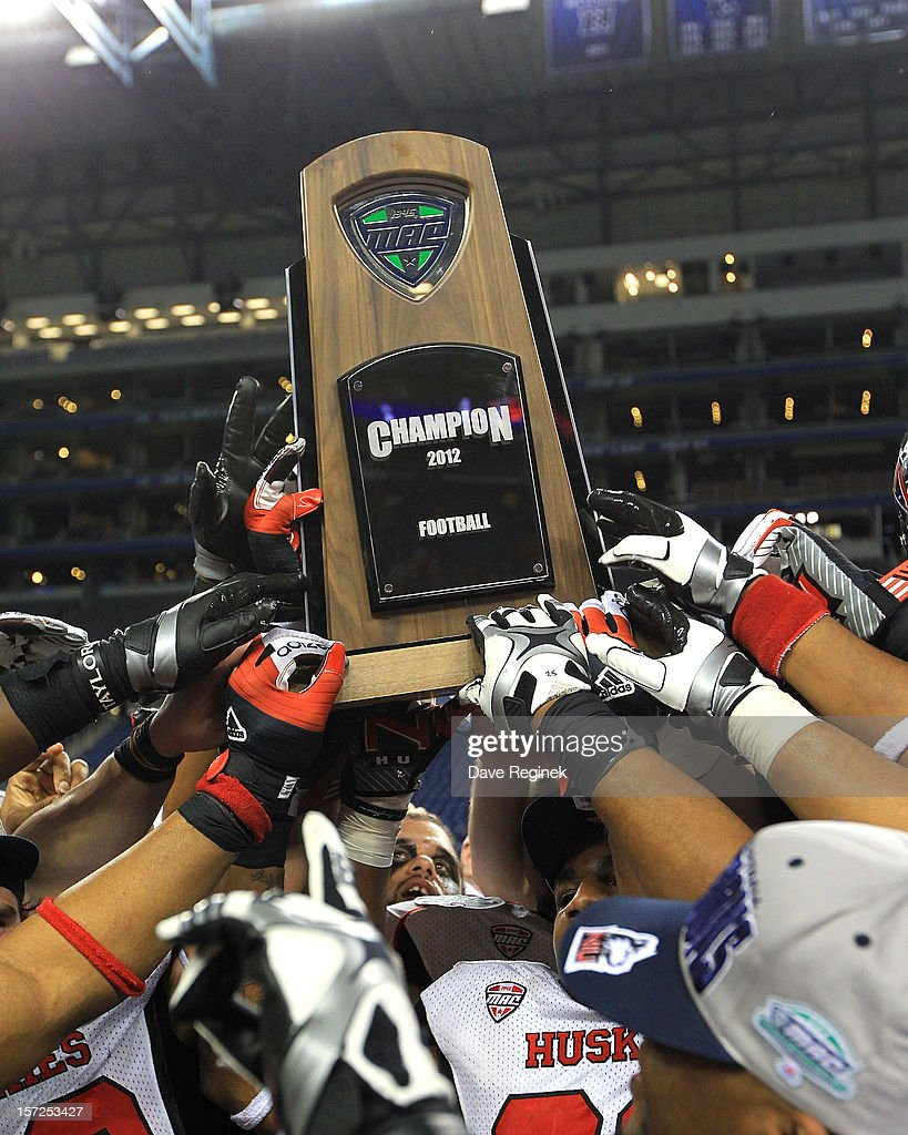 The Northern Illinois Huskies hold the championship trophy high after defeating the Kent State Gold Flashes 44-37 during the Mid-American Conference Championship game at Ford Field on November 30, 2012 in Detroit, Michigan.
