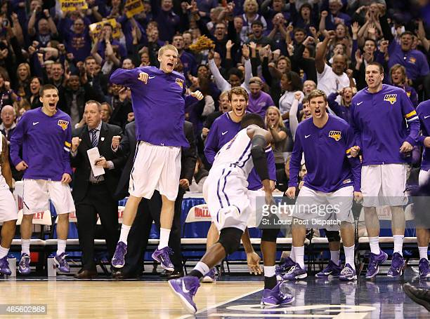 The Northern Iowa bench reacts after guard Wes Washpun foreground was fouled while scoring during the second half of the MVC tournament game between...