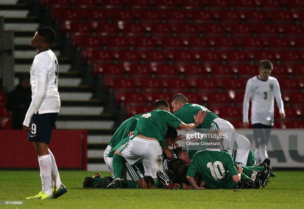 The Northern Ireland team celebrate after their team-mate Shea Conaty scored a goal during the Victory Shield match between England U16 and Northern Ireland U16 at Goldsands Stadium on November 08, 2013 in London, England.