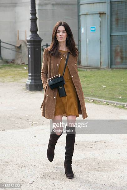 'The Northern Lightâ blogger Hedvig Opshaug wears Stuart Weitzman shoes Mango coat Dagmar dress Charlotte Olympia bag and M2 Mallitier bag on day 5...