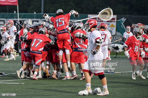 The Northern Patriots celebrate their win over Glenelg in the Maryland State 3A/2A lacrosse championship game on May 23 2017 in Stevenson MD