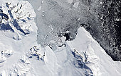 The northern tip of Alexander Island, near the western base of the Antarctic Peninsula, illustrates one of the processes through which glaciers can contribute to sea level rise: iceberg production. In