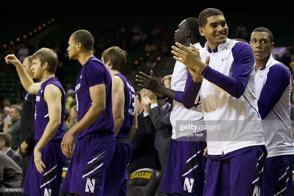 The Northwestern University Wildcats bench celebrates against the Baylor University Bears on December 4, 2012 at the Ferrell Center in Waco, Texas.