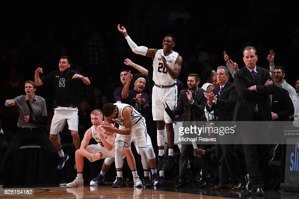 The Northwestern Wildcats bench reacts against the Notre Dame Fighting Irish in the first half during the championship game of the Legends Classic at...