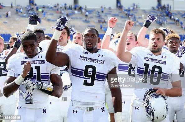 The Northwestern Wildcats celebrate after defeating the Duke Blue Devils 1910 at Wallace Wade Stadium on September 19 2015 in Durham North Carolina