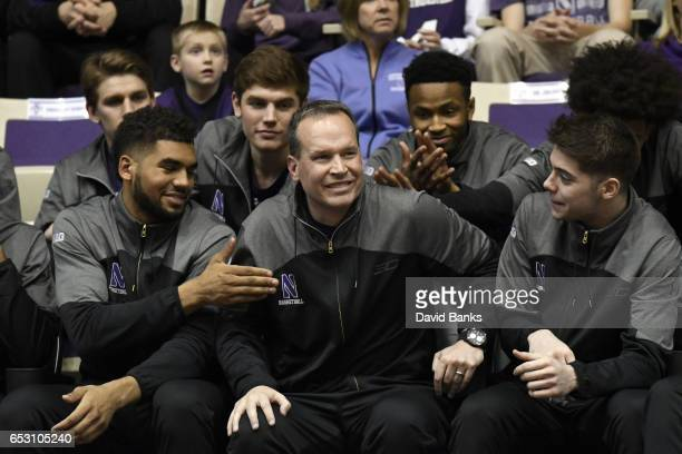 The Northwestern Wildcats react with their head coach Chris Collins of the Northwestern Wildcats after being selected to play Vanderbilt during a...