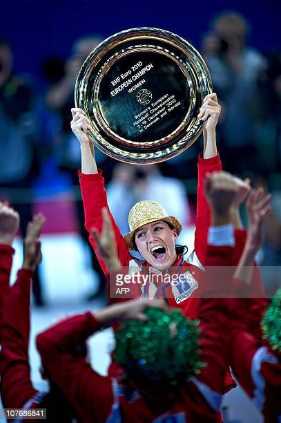 The Norwegian captain Gro Hammerseng raises the trophy on December 19 during the podium ceremony of the 9th Women's Handball European Championships...