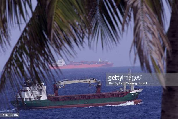 The Norwegian freighter MV Tampa sits off the coast of Christmas Island as another Scandanavian boat a resupply vessel for the island Thor Kirsten...