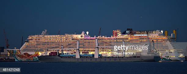 The Norwegian Getaway sits moored as the 200Meter long cargo ship 'Wladyslaw Orkan' passes by November 21 2013 in Bremerhaven Germany The Norwegian...