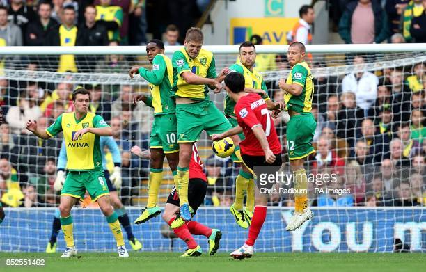 The Norwich City wall attempt to block the freekick from Cardiff City's Peter Whittingham