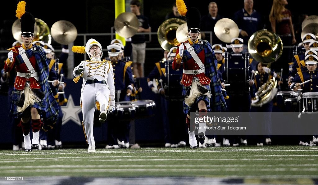 The Notre Dame band takes the field during a game against Arizona State at AT&T Stadium in Arlington, Texas, Saturday, October 5, 2013. Notre Dame beat ASU, 37-34.