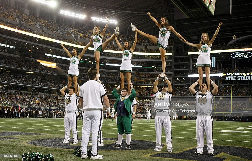The Notre Dame cheerleaders perform during a college football game against Arizona State at AT&T Stadium in Arlington, Texas, Saturday, October 5, 2013. Notre Dame beat ASU, 37-34.