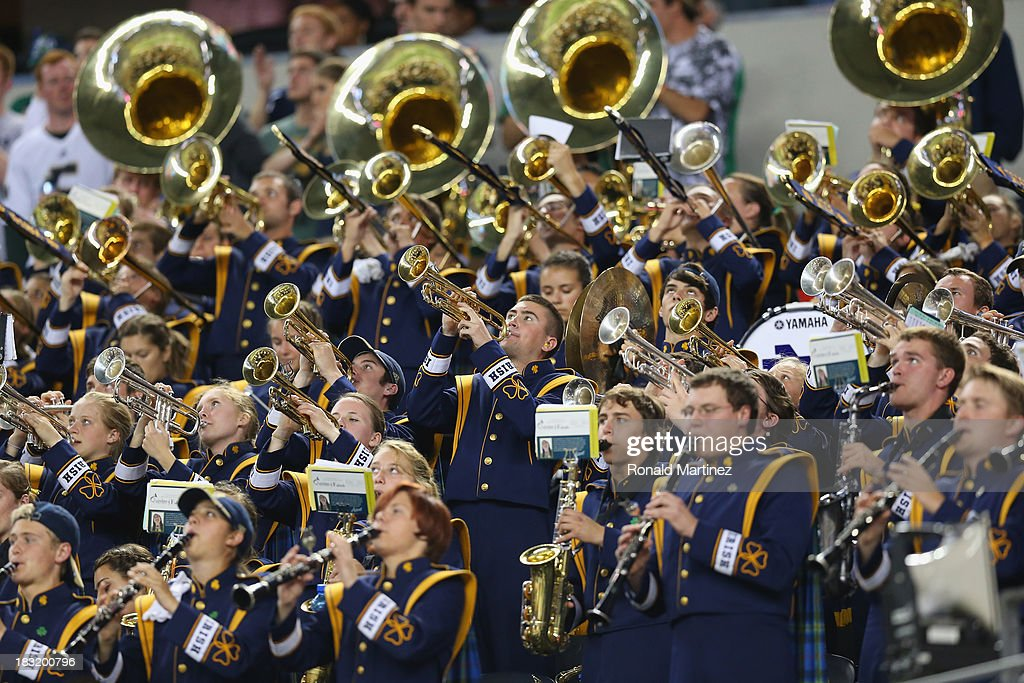 The Notre Dame Fighting Irish band performs at Cowboys Stadium on October 5, 2013 in Arlington, Texas.