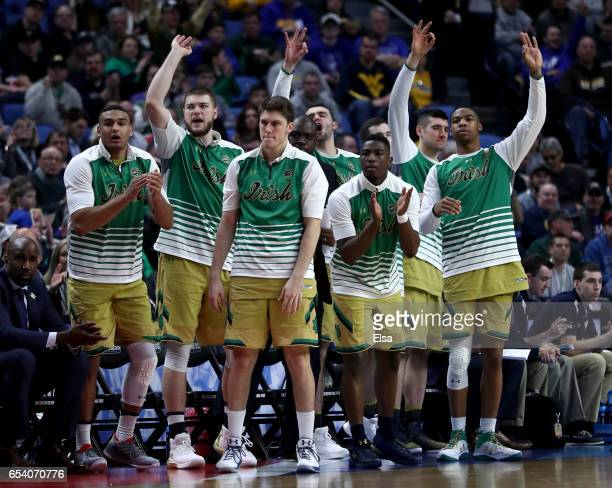 The Notre Dame Fighting Irish bench celebrates a three point basket during the first half against the Princeton Tigers during the first round of the...