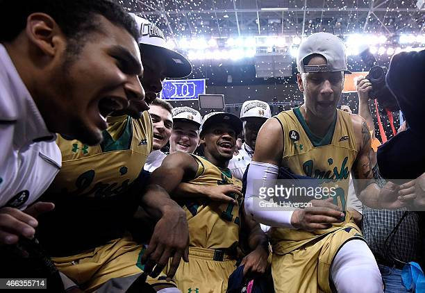 The Notre Dame Fighting Irish celebrate after defeating the North Carolina Tar Heels during the championship game of the ACC Basketball Tournament at...