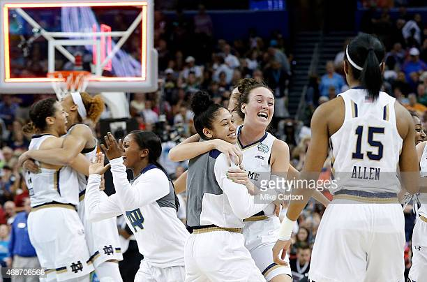 The Notre Dame Fighting Irish celebrate their 66 to 65 win over the South Carolina Gamecocks during the NCAA Women's Final Four Semifinal at Amalie...