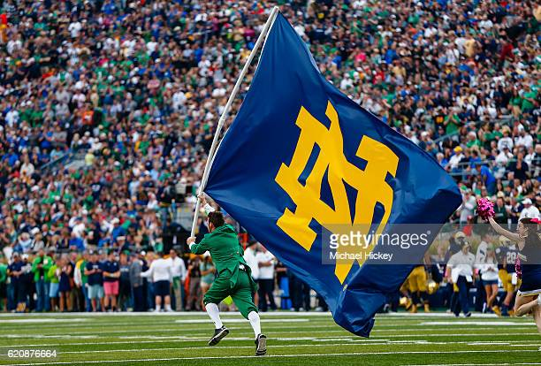 The Notre Dame Fighting Irish mascot carries the Notre Dame Fighting Irish flag during the game against the Miami Hurricanes at Notre Dame Stadium on...