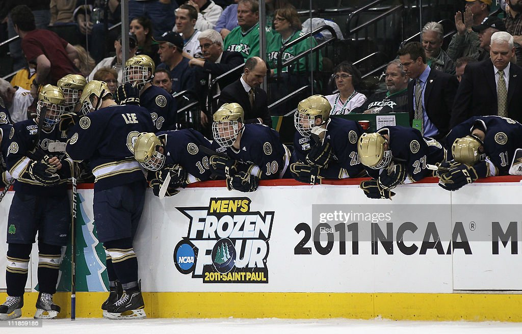 The Notre Dame Fighting Irish react to their loss to the Minnesota Duluth Bulldogs during semifinals of the 2011 NCAA Men's Frozen Four on April 7, 2011 at the Xcel Energy Center in St. Paul, Minnesota. The Minnesota Duluth Bulldogs defeated the Notre Dame Fighting Irish 4-3.