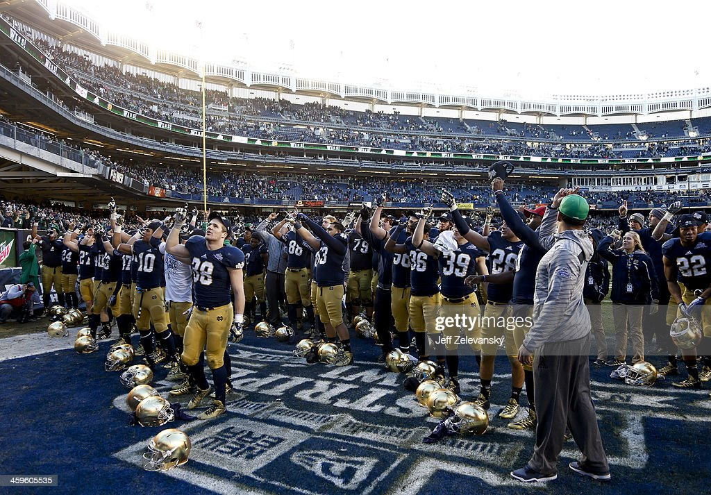The Notre Dame Fighting Irish salute fans after winning against the Rutgers Scarlet Knights in the New Era Pinstripe Bowl at Yankee Stadium on December 28, 2013 in the Bronx borough of New York City.
