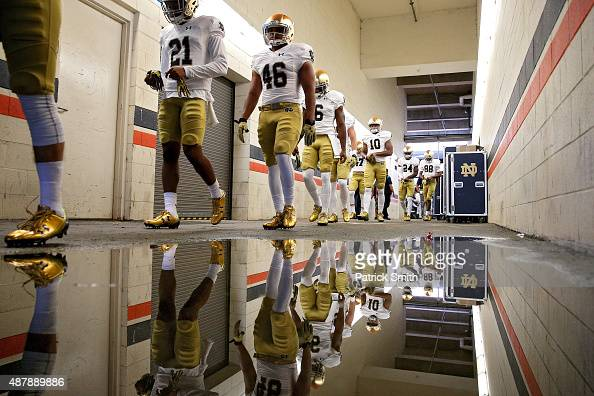 The Notre Dame Fighting Irish walk to the field for warmups before playing the Virginia Cavaliers at Scott Stadium on September 12 2015 in...