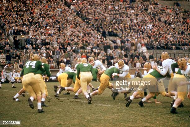 The Notre Dame varsity team hands the ball off against the Notre Dame alumni team during an alumni game on April 16 1957 at Notre Dame Stadium in...